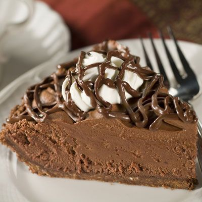 Chocolate Lover's Chocolate Mousse Pie ~ This amazing pie has a chocolate crust with a milk chocolate coating, fluffy chocolate filling, whipped cream and is topped with a chocolate drizzle. Perfect elegant pie for the holidays!