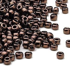 Seed bead, Dyna-Mites™, glass, iris dark bronze, #6 round. Sold per 40-gram pkg.