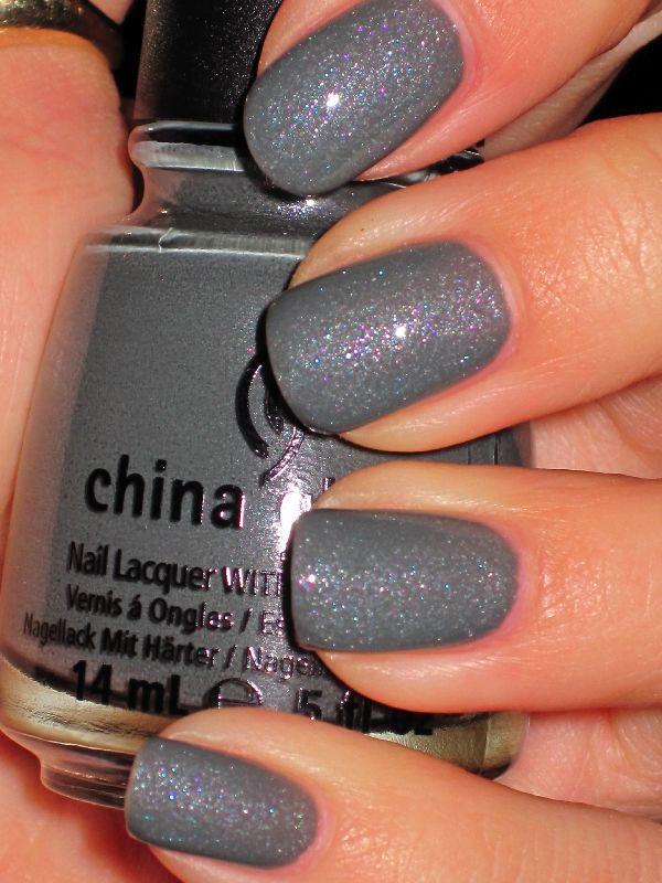 "Shimmery Charcoal Gray perfect on fair skin. I absolutely love this color. By China Glaze in the shade ""Immortal."""