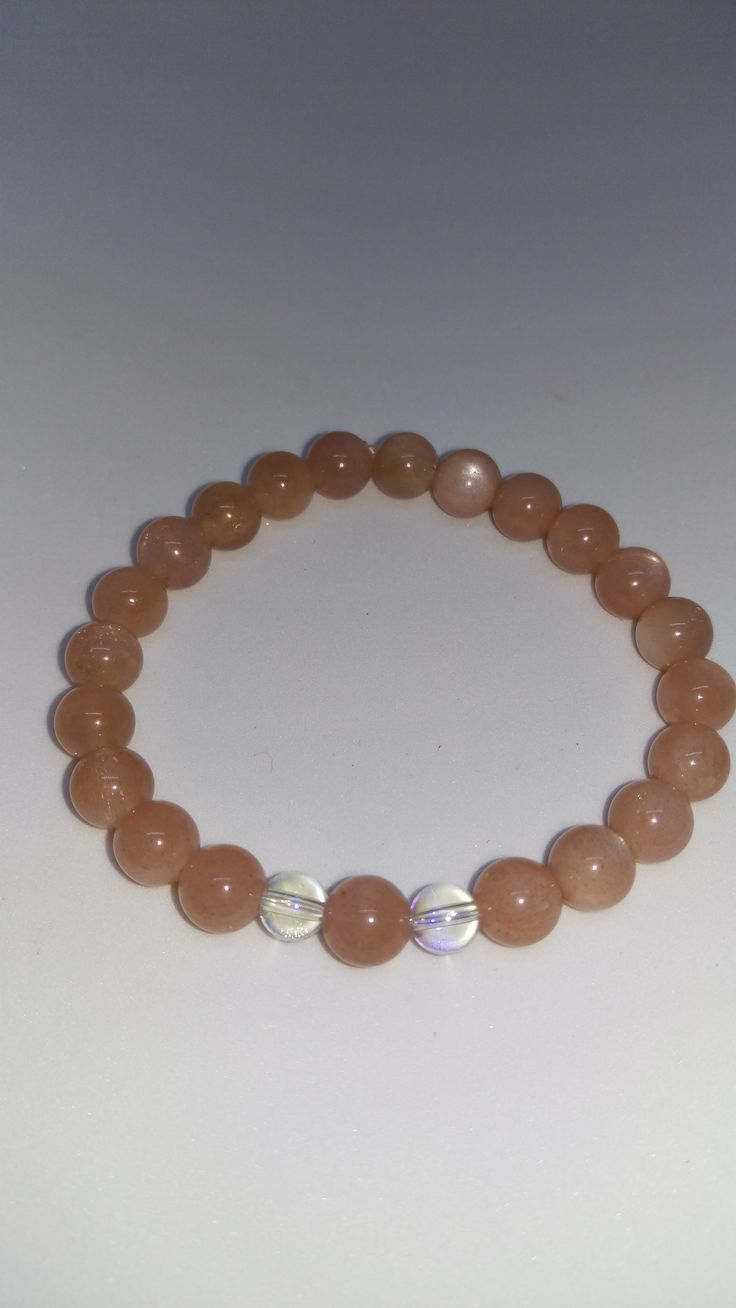 Sunstone 8 mm AAA Grade Stretch Bracelet  with Angel Aura Beads. This amazing , very optimistic stone helps us to discover our own nature. Wear it alone or pair it with other bracelets.
