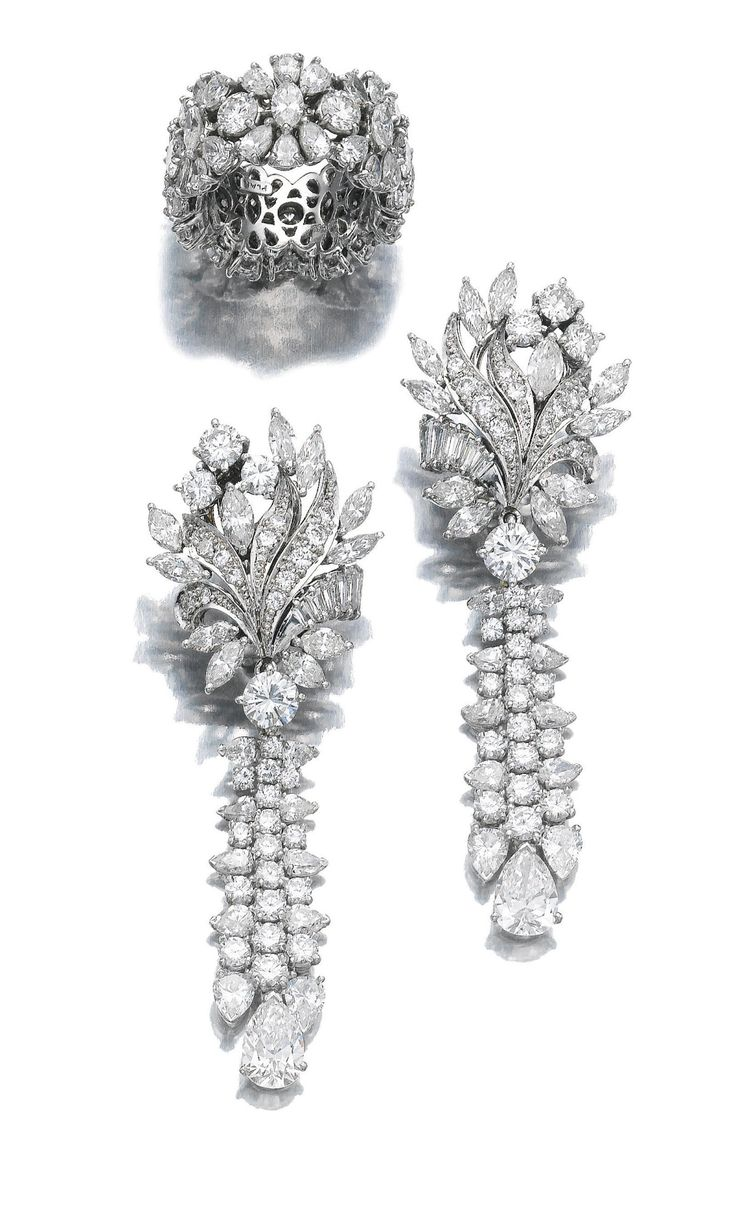 Pair of diamond pendent earrings and a ring Each earring featuring a surmount of floral design suspending a tassel motif, set with marquise-, pear-shaped, brilliant-cut and baguette diamonds; the ring designed as a wide band, similarly set.