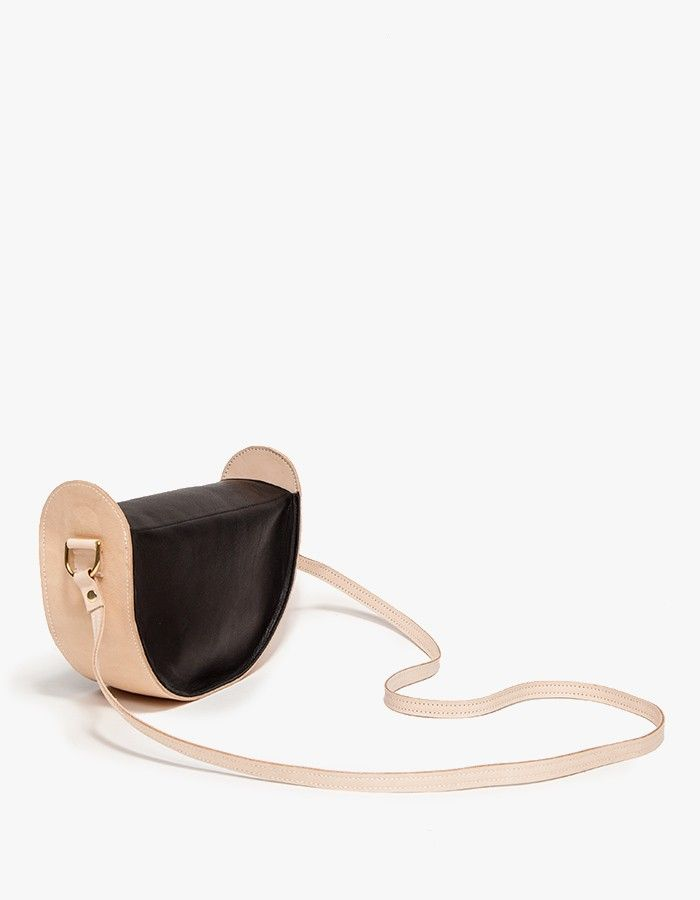 Two-tone leather crossbody from Job & Boss crafted from vegetable-tanned nude and black Mellowtan leathers. Features leather linded interior for a molded, stiff feel. • Two tone leather crossbody bag • Vegetable tanned nude leather • Black Mellow