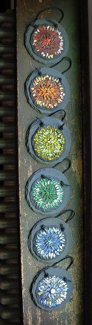 "Mosaic Mandala Rainbow by Margaret Almon of Nutmeg Designs    Series of 6 mosaic mandala's,  glass, dichroic and mother of pearl on 5"" diameter slate"