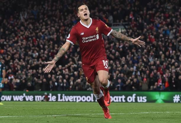 Liverpool's Brazilian midfielder Philippe Coutinho celebrates scoring his team's third goal during the English Premier League football match between Liverpool and Southampton at Anfield in Liverpool, north west England on November 18, 2017. / AFP PHOTO / PAUL ELLIS / RESTRICTED TO EDITORIAL USE. No use with unauthorized audio, video, data, fixture lists, club/league logos or 'live' services. Online in-match use limited to 75 images, no video emulation. No use in betting, games or single…