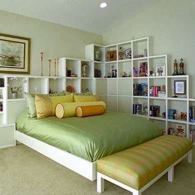 Useful in every room of the house, modular shelving units in the bedroom form a storage headboard