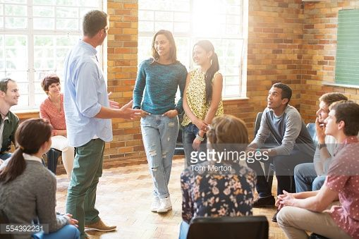 Stock Photo : Man and women talking in group therapy session