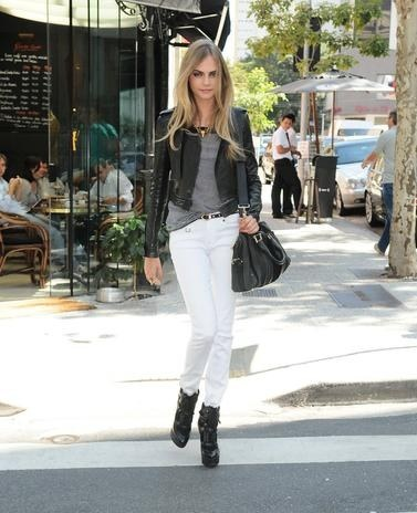 Cara Delevingne in leather jacket with white jeans