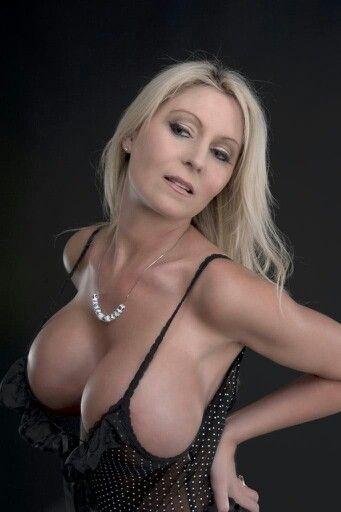 Mature women in dresses having sex
