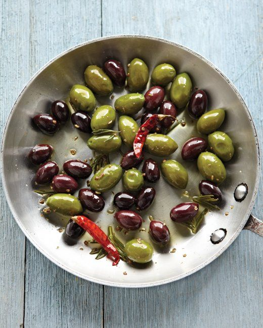 Warm Marinated Olives ~ Heating herbs and spices in oil extracts their flavors, making it easy for olives to take on their aromatic essence.