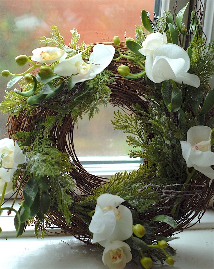Rustic twig wreath with cypress pine, mistletoe & beautiful white orchids.  Made to last.