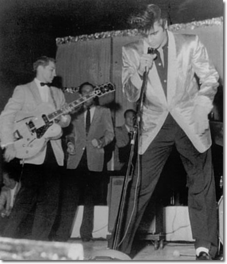 Scotty Moore, Elvis and the Jordanaires onstage at Empire Stadium, August 31, 1957. (Click on image for larger view).