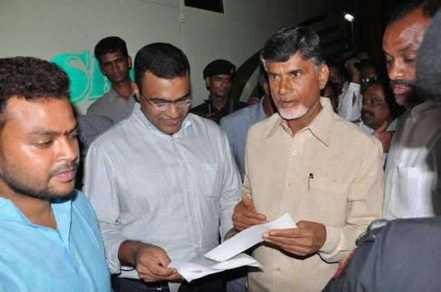 Trimex Sands Private Limited Managing Director Pradeep Koneru handing over a demand draft for Rs. 50 lakh to Chief Minister N.Chandrababu Naidu during latter's visit to Srikakuam, towards relief operations in cyclone-hit areas.