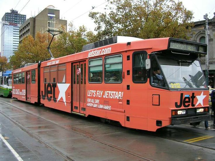 Melbourne Tram B2.2112 shows off its all over ad for JetStar while operating route 59 to Airport West at Victoria Market, Tuesday, 18th May 2004