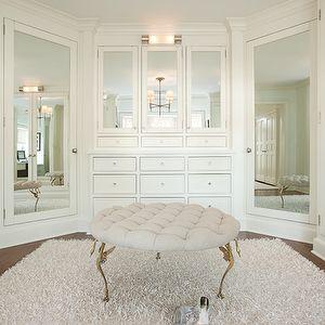 Ali Schwarz Design Group - closets - walk-in closet, linen ottoman.