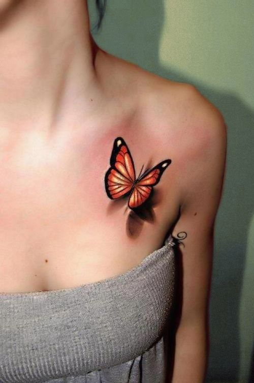 Fresh orange butterfly tattoo chest