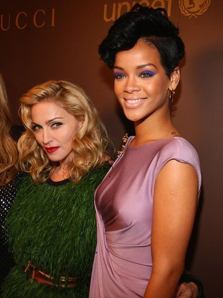 Madonna and Rihanna 2008 god alone knows what madge is wearing here ?
