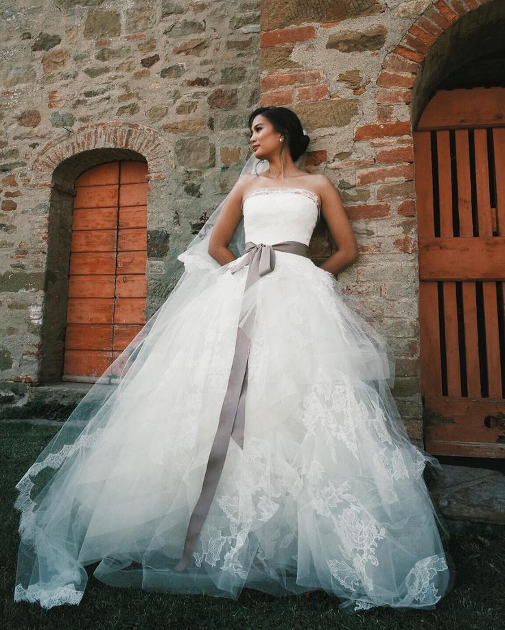 Filipino actress Isabelle Daza in a Vera Wang wedding gown with ribbon belt at her destination nuptials at Castello di Gargonza, Italy {Facebook and Instagram: The Wedding Scoop}