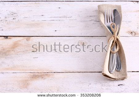 Seasonal white wooden table with cutlery