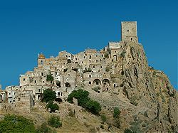 Craco, Italy. This village was founded no later than 1080, but despite its longevity Craco suffered many changes of fortune over the centuries due to political strife and geological upheaval. Recurring earthquakes took a toll on the town throughout the mid-20th century and the entire population was moved to a nearby valley in 1963.