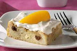 Cuban bread gets a sweet and creamy combination of sliced peaches and cream cheese in this easy bread pudding recipe.