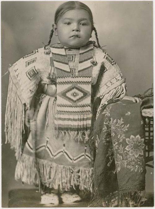 Cheyenne girl wearing an elaborate beaded dress and breastplate, 1915. Oklahoma.