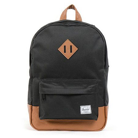 Old school class meets practicality and functionality. The medium size Heritage backpack from Herschel Supply Co in the black colorway. It's a simple and organized backpack with nice padding for you and your gear. Plenty of main compartment storage and an easy access front zipper pocket for the small stuff. Stay organized and classy in the Heritage backpack from Herschel Supply. Shop more colors of Herschel Heritage Backpacks and Herschel Heritage Laptop Cases  here.