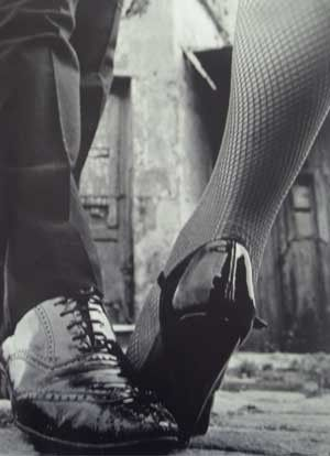 Wingtips and heels....You know you have a problem when you see this a Blair and Chuck.