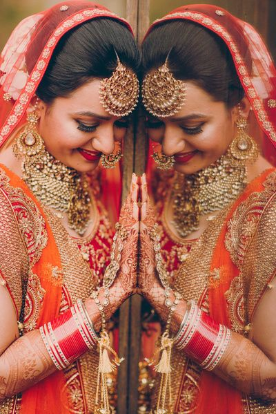 Maang tikka, choker jewellery , orange and red duoatta , bride getting ready