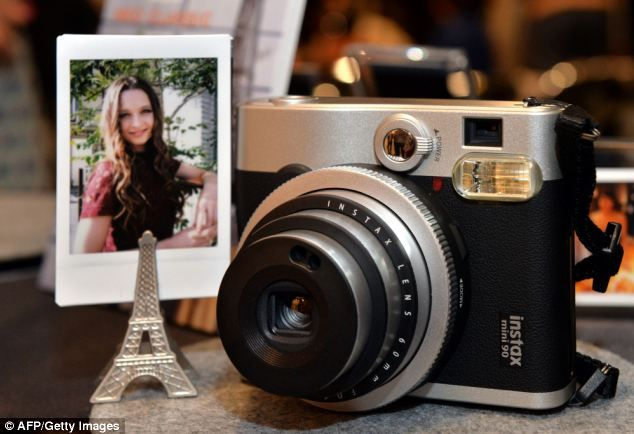 Japanese camera maker Fujifilm has unveiled its Instax mini 90 Neo Classic, pictured, that prints card-sized photos instantly.