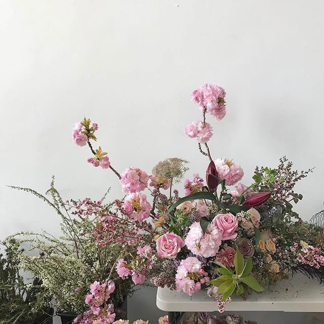 Monday morning dose of floral courtesy of #DesignbyTerrain for our gals at @BHLDN. Pictured: flowering cherry, a mix of garden, spray, and standard roses, lilac, lily, leptospermum, spirea, and chocolate Queen Anne's lace.
