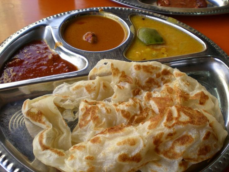 Roti Canai - Roti canai is a type of Indian-influenced flatbread found in Malaysia and Indonesia. It is often sold in Mamak stalls in Malaysia;