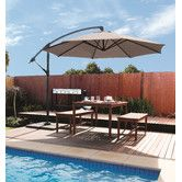 Perfect poolside, a great addition to any sunset-soaked dinner party and fantastic for general use in the garden or around the home, the 12' Round Cantilever Patio Umbrella is the portable canopy that's capable of handling it all.