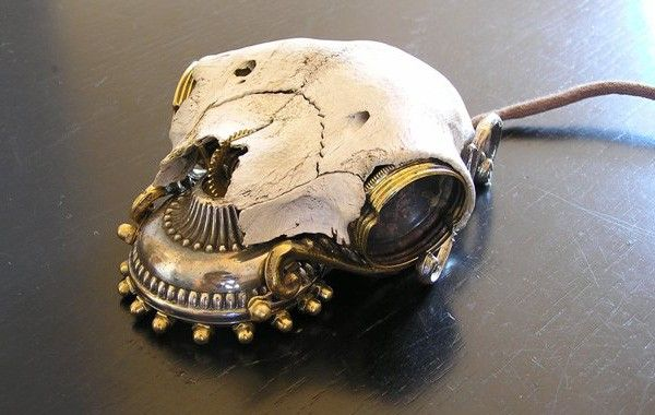 Steampunk mouse, now with 100 percent more skull~Made from a real sheep's skull -- and real brass, though that's somehow less interesting -- this mouse has everything a megalomaniacal world conqueror needs to feel at home: fine ornamental detailing, the soothing texture of real bone, and the enticing mental image of crushing skulls every time you click.