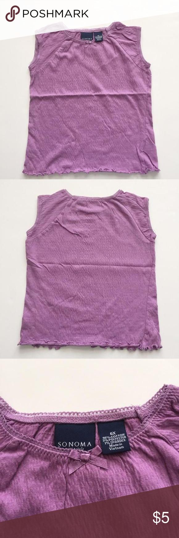 🍄PURPLE SMOCKED TOP This purple top it's in like new  condition.  this is a fully smocked top. Perfect for the Sumer! 🌸BUNDLE AnD SAVE MORE🌸 Sonoma Shirts & Tops Tees - Short Sleeve
