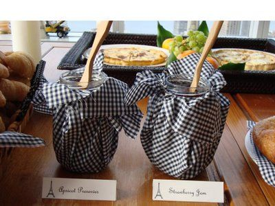 Wrap your serving jars with a cut of fabric and tie off with a rubber band, ribbon or twine - you can leave all your condiments in the original jars AND have them look pretty