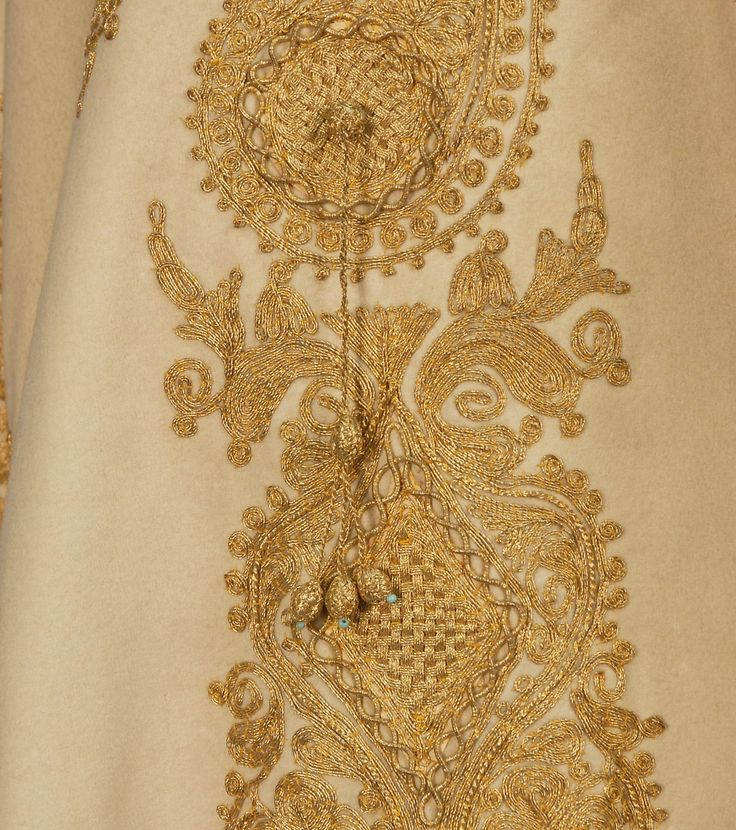 DETAIL OF THE EMBROIDERY ON THE FELTED WOOL CAPE with METALLIC GOLD CORD, c. 1900.