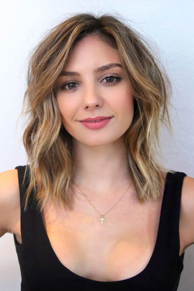 Check out these flirty haircuts for square faces that angle your face and highlight your cheekbones!