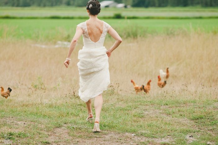yes that is #thebride chasing chickens…love #pemberton see more www.blissevent.ca Photographers www.shariandmike.ca