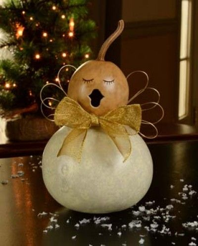 The caroling angels are singing songs and spreading joy. They each come with gold bows and gold wings. Julia has a white body and natural colored head and is approximately 3 1/2