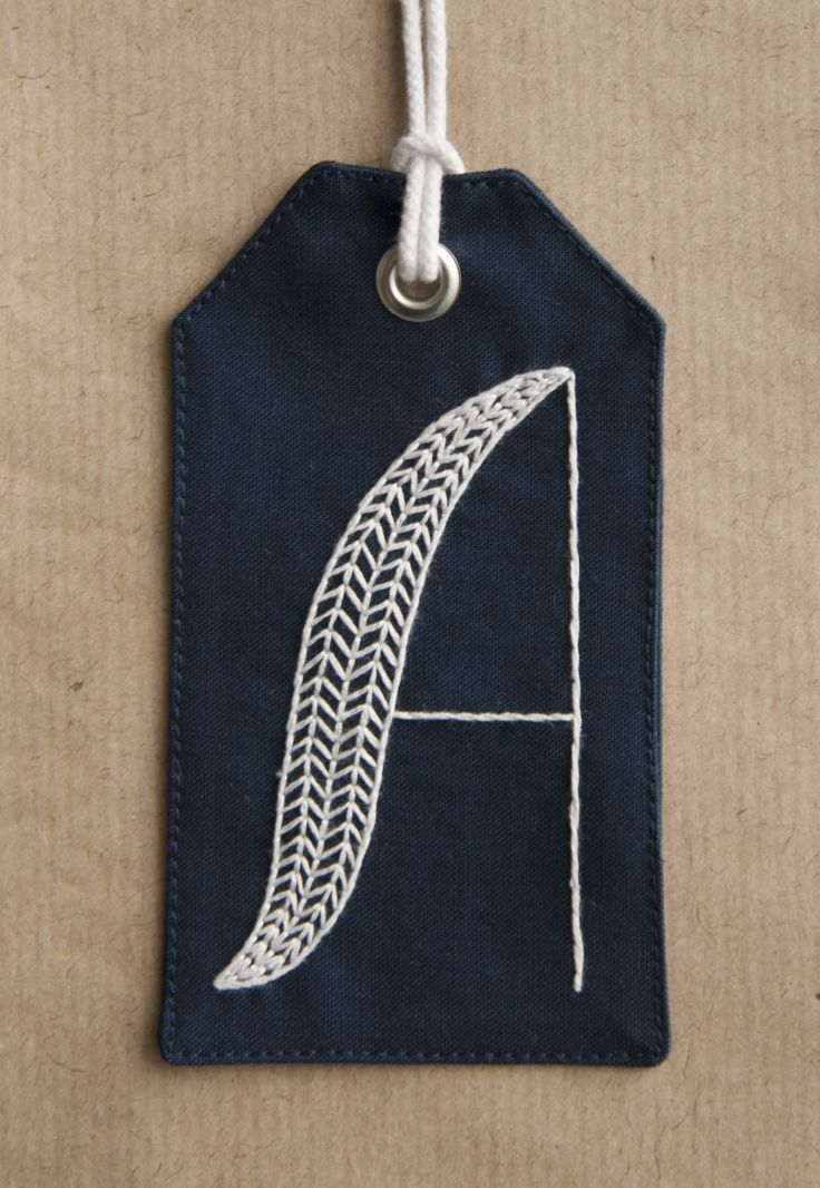 Squibblybups hand-embroidered gift tag with the initial 'A' in herringbone.