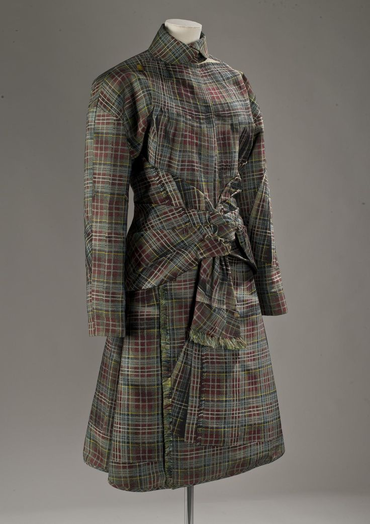 Woman's jacket, part of an ensemble with skirt K.2005.70.2, of red, grey, yellow and black polyester tartan fabric produced from a digital photograph of tartan and kilts, woven using a computer controlled Jaquard loom: fabric by Aeffe, Italy, jacket designed by Jean Paul Gaultier, Autumn/Winter 2004 - 2005
