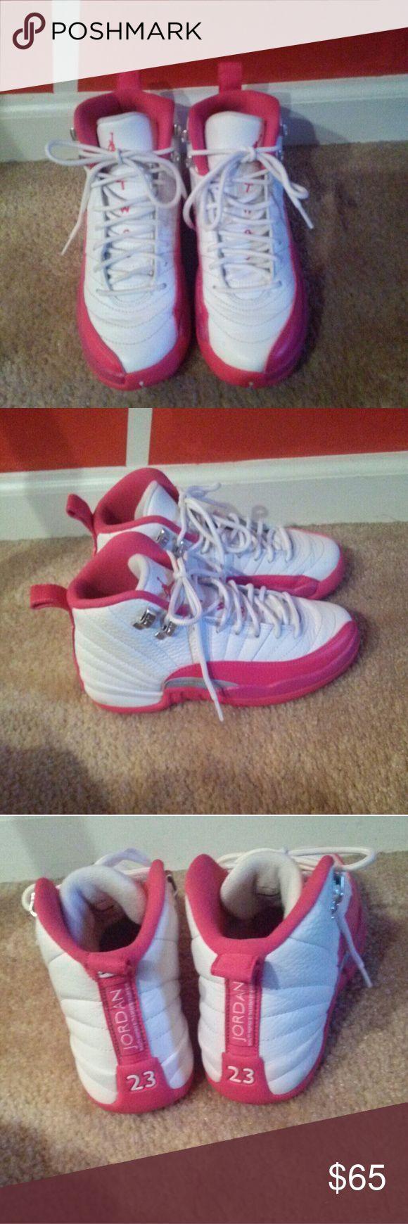 Jordan retro 12 Pink/white Jordan retro 12 gently used in excellent condition, no scuffs or scrapes. 4y in boys = 6 in women Jordan Shoes Sneakers
