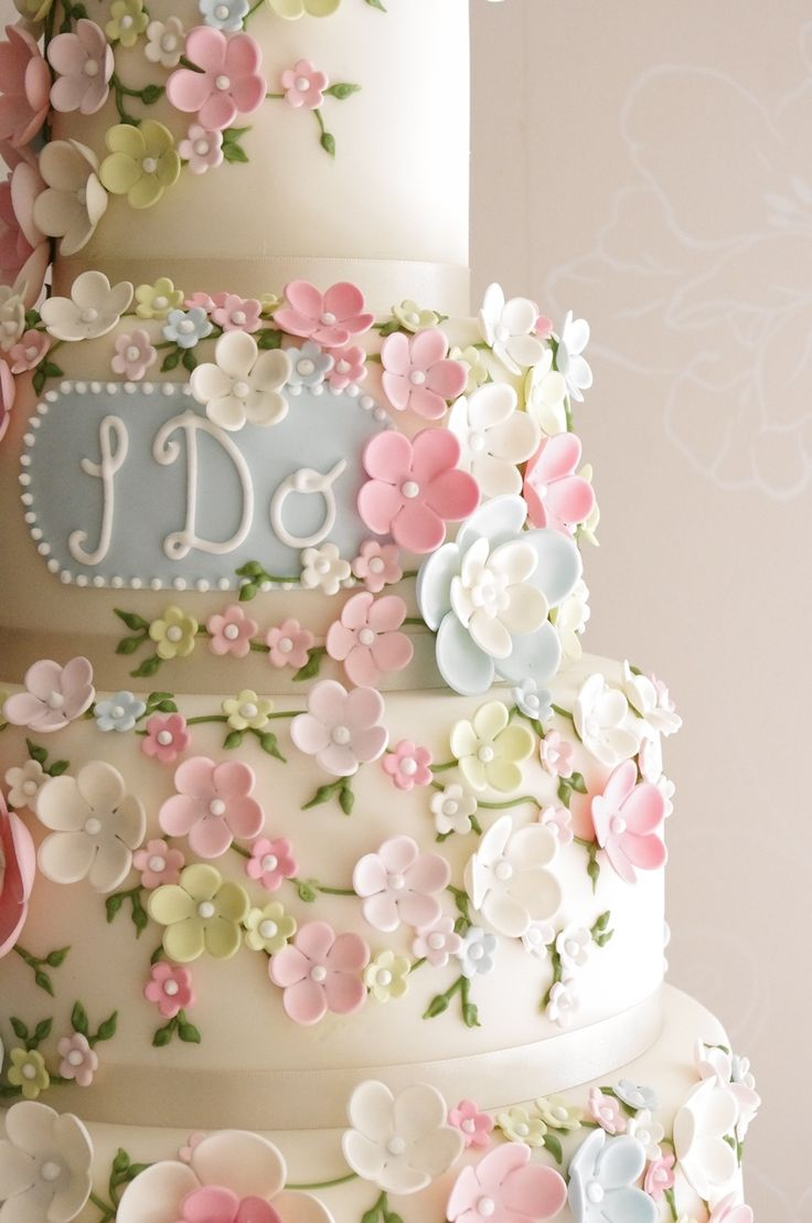 Pastel floral wedding cake  For more wedding ideas visit www.myiomwedding.im