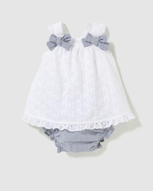 1c736f8f23a5c Vestido de bebé niña Dulces en blanco con lazos