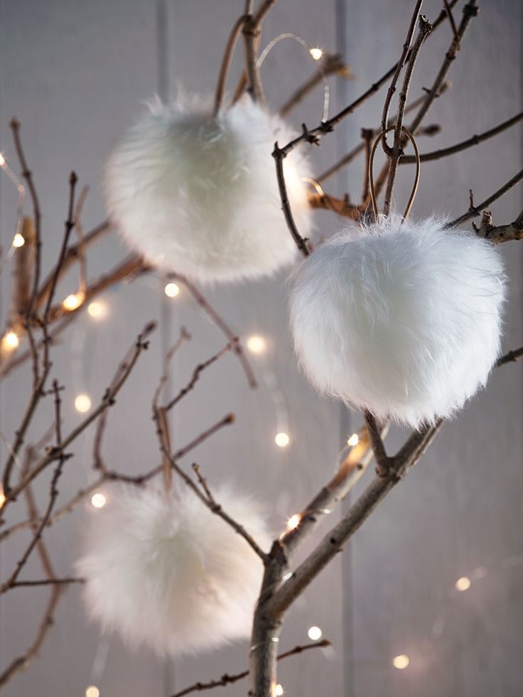 Carefully handmade from sumptuous longhair ivory sheepskin in the UK, this beautiful sheepskin pompom makes the perfect festive decoration or gift. Complete with a leather loop for hanging from your tree, doorknob or around your keys; treat yourself to a touch of grown up luxury with this supersoft pompom.