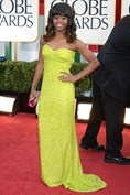 Golden Globe 2013 via British Vogue Olympic gymnast Gabrielle Douglas wore a neon yellow strapless gown. Photo By Rex Features