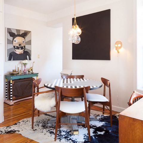 Jeanette Dalrot (@nettan_bettan) creates cozy downtown interiors from TriBeCa to Paris. And her own New York apartment reveals her obsessive attention to detail. Dalrot epoxied the dining room table herself and used Memphis Group hues for the hallway side table. She reupholstered the dining room chairs, also from Craigslist, with leather from Etsy. Photo by @ncott.
