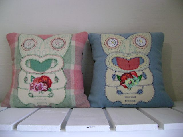 Tiki holding flowers cushions