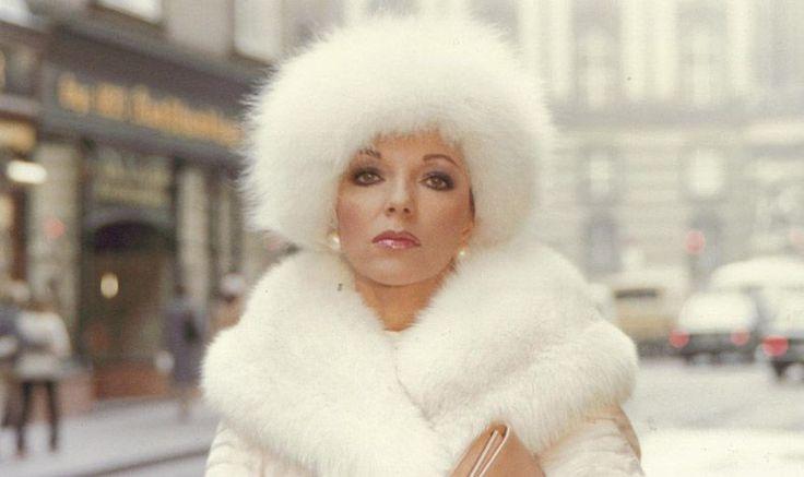 Joan Collins in white fur