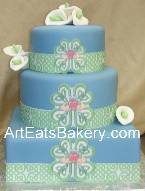 ❁❚❘❙       Custom blue fondant square and round green Celtic and Cladaugh design wedding cake with sugar calla lillies by arteatsbakery, via Flickr